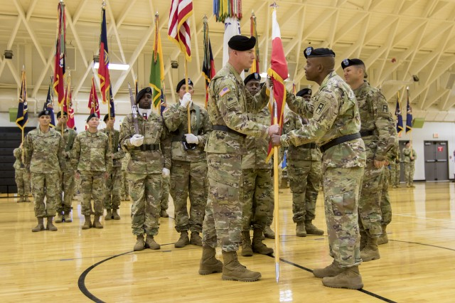Army Lt. Gen. Stephen Twitty, right, commanding general of First Army, passes the division colors to incoming First Army Division East commanding general, Army Maj. Gen. Terrence McKenrick, during a Change of Command and Change of Responsibility Ceremony, June 26, 2018 at Fort Knox, Ky. During the ceremony, the outgoing command sergeant major for the unit, Command Sgt. Maj. Royce Manis -- who soon retires after 30 years of military service -- relinquished his responsibility to Command Sgt. Maj. Carl Fagan. (U.S. Army photo by Sgt. 1st Class Darron Salzer, First Army Division East)