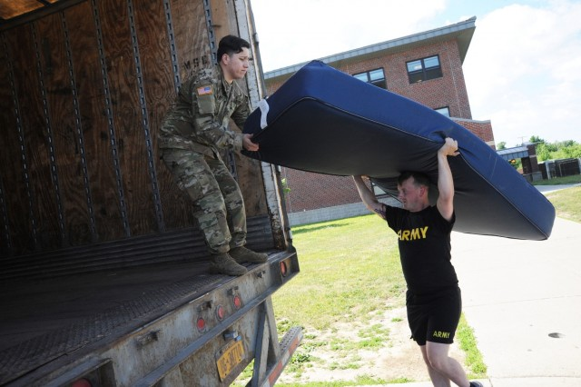 Soldiers from 2nd Battalion, 87th Infantry Regiment, 2nd Brigade Combat Team, load up a truck with old mattresses from the barracks. Under the Fort Drum Public Works' Solid Waste Program, mattresses are being sent to a recycling company near Buffalo, New York, so that the materials can be separated and used for new products. (Photo by Mike Strasser, Fort Drum Garrison Public Affairs)
