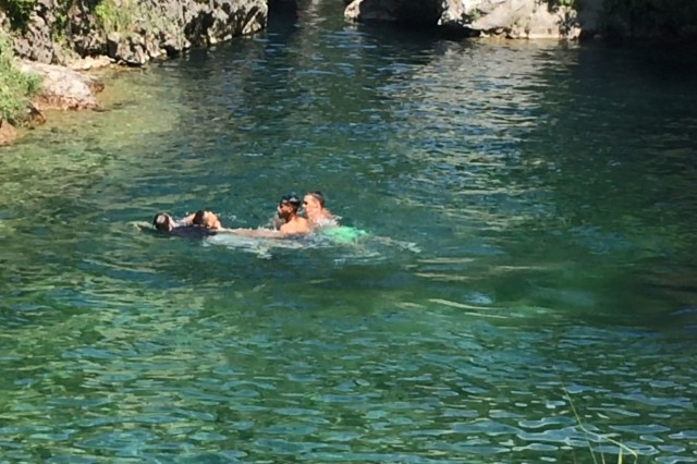 A local citizen is saved from drowning in the frigid waters of Pria Park, a local swimming hole in the Dolomite Mountains of northern Italy, by Lt. Col. John Hall, a paratrooper in the 173rd Airborne Brigade, June 2018.