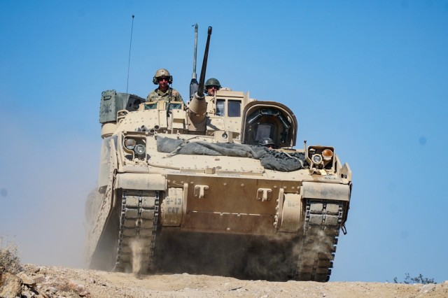Soldiers assigned to 2nd Squadron, 13th Cavalry Regiment, 3rd Armored Brigade Combat Team, 1st Armored Division maneuver a Bradley Fighting Vehicle during training operations at the National Training Center in Fort Irwin, California May 27-June 17, 2018.