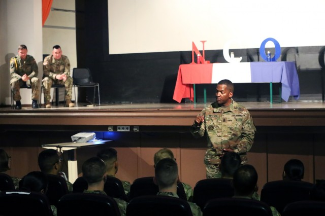 U.S. Army Command Sgt. Maj. Ulysses Rayford, the U.S. Army Installation Management Command - Europe senior enlisted leader, speaks to new U.S. and German Army noncommissioned officers at an NCO induction ceremony, June 28, 2018, in Wiesbaden, Germany. (U.S. Army photo by William B. King)