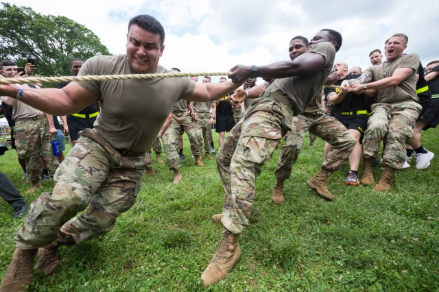 Soldiers compete in a tug of war against Marines during Joint Base Myer-Henderson Hall's fifth annual Urban Warrior Challenge and joint base barbecue June 21.