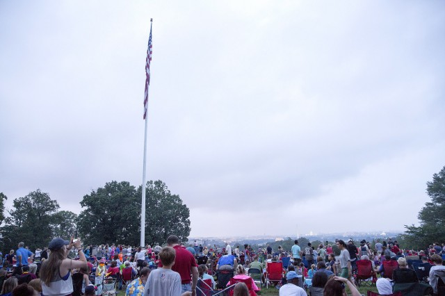 Hundreds of spectators on Whipple Field at the Fort Myer portion of Joint Base Myer-Henderson Hall wait out rainy conditions to view a fireworks display July 4, 2015
