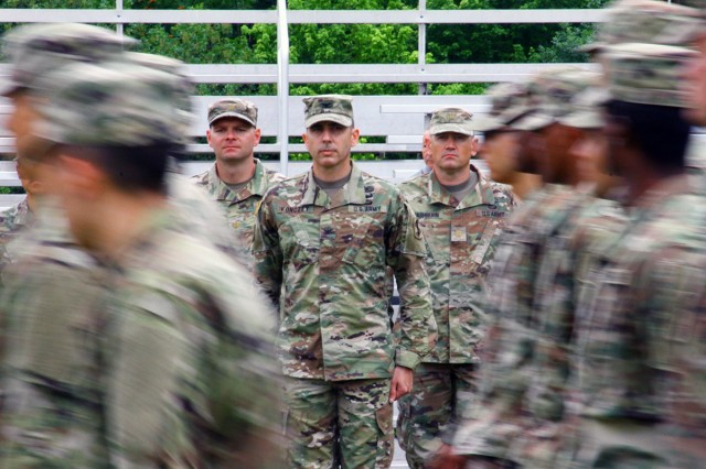 Col. Michael Konczey (center), 434th FA Brigade commander, watches basic combat trainees go by during the pass-in-review portion of the change of command, and responsibility ceremony, June 25,  2018, at Polo Field.