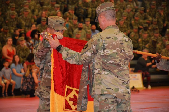 The 75th Field Artillery Brigade command team of Col. Steven Carpenter and Command Sgt. Maj. Charles Masters uncase the colors at the brigade headquarters redeployment ceremony May 21, 2018, at Rinehart Fitness Center on Fort Sill, Okla.