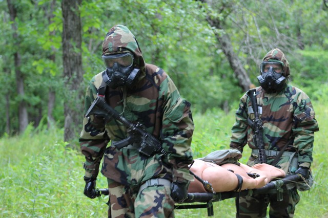 Team 4, consisting of 2nd Lts. Eric Thompson and Jacob Van Horn from Fort Campbell, Kentucky, carries a simulated casualty to safety during the 2018 Best CBRN Warrior Competition at Fort Leonard Wood.