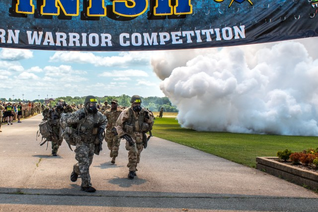 Teams run for the Best CBRN Warrior Competition finish line June 23 on Fort Leonard Wood's Gammon Field.