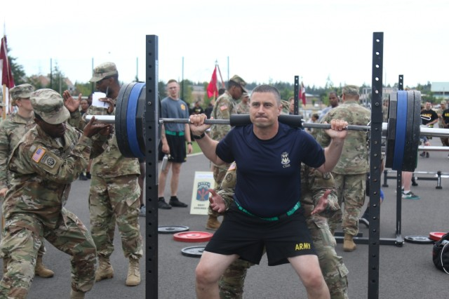 Lt. Col. Casey J. Holler, commander, 13th Combat Sustainment Support Battalion, participates in the max weight event during the 593rd Expeditionary Sustainment Command Rest Assured Challenge 27 June at Joint Base Lewis-McChord, Washington. 593rd ESC hosted a 3-day Rest Assured Challenge June 25 to June 27 at Joint Base Lewis-McChord, Washington. The challenge had seven events in which teams from four to 21 Soldiers could participate in. Each event awarded points to the first, second and third place. After three days of events the trophy was presented to the command who attained the most points overall.