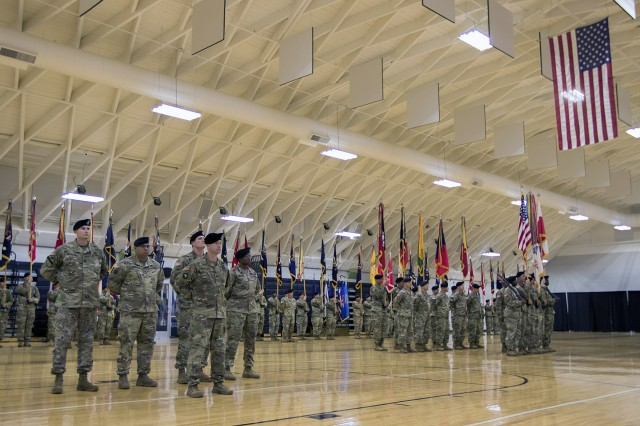 Several First Army Division East staff and brigade representatives participate in the ceremony.