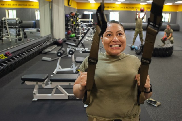Sgt. Sandy Barrientos, a combat photographer at the Visual Information Support Center, participates in a functional fitness workout inside the Health and Human Performance Center at Camp Casey, South Korea, May 29, 2018. Barrientos and other Soldiers, who have garrison roles at the remote camp, conduct multiple fitness sessions each duty day in an effort to improve their readiness and stay physically fit.