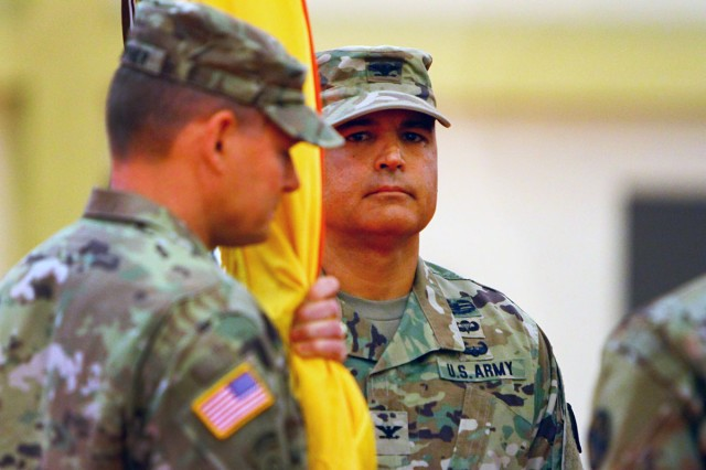 Maj. Gen. Wilson A. Shoffner, Fires Center of Excellence and Fort Sill commanding general, prepares to hand the 428th FA Brigade colors to Col. Jeffrey Buck, symbolizing Buck's acceptance of command June 22, 2018, at Fort Sill, Oklahoma.