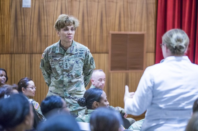 The U.S. Army Surgeon General Lt. Gen. Nadja West, commander of U.S. Army Medical Command, listens as Maj. Jordanna Hostler, right, chief of Sleep Medicine at Tripler Army Medical Center inquires about the future of Army Medicine during a town hall hosted by TSG, June 21, 2018 for TAMC staff members, beneficiaries, and other Army Medicine personnel throughout the area of responsibility.