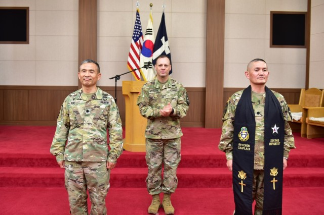 CAMP HUMPHREYS, Republic of Korea -- Chaplain (Lt. Col.) Moon H. Kim, outgoing 2nd Infantry Division ROK-U.S. Combined Division command chaplain (left), Maj. Gen. D. Scott McKean, 2ID/RUCD, commanding general (center), Chaplain (Lt. Col.) Hyeonjoong Kim, incoming 2ID/RUCD command chaplain (right) face Soldiers during the Change of Stole Ceremony held at the Warrior Chapel June 21. Incoming Chaplain (Lt. Col.) Hyeonjoong Kim receives the stole to signify acceptance of 2ID/RUCD command chaplain responsibility. (U.S. Army photo by Mr. Pak Chin U. 2ID/RUCD Public Affairs)
