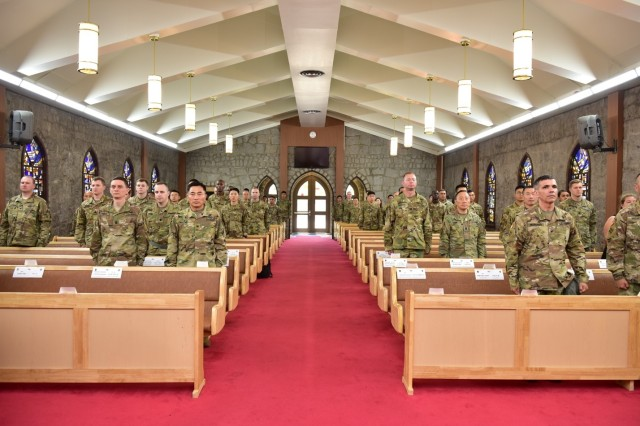 CAMP RED CLOUD, Republic of Korea -- 2nd Infantry Division ROK-U.S. Combined Division Soldiers observe the Change of Stole Ceremony held at the Warrior Chapel June 21. The Change of Stole Ceremony signifies transfer of command chaplain responsibility from Chaplain (Lt. Col.) Moon H. Kim, outgoing 2ID/RUCD command chaplain to Chaplain (Lt. Col.) Hyeonjoong Kim, incoming 2ID/RUCD command chaplain. (U.S. Army photo by Mr. Pak Chin U 2ID/ RUCD Public Affairs)