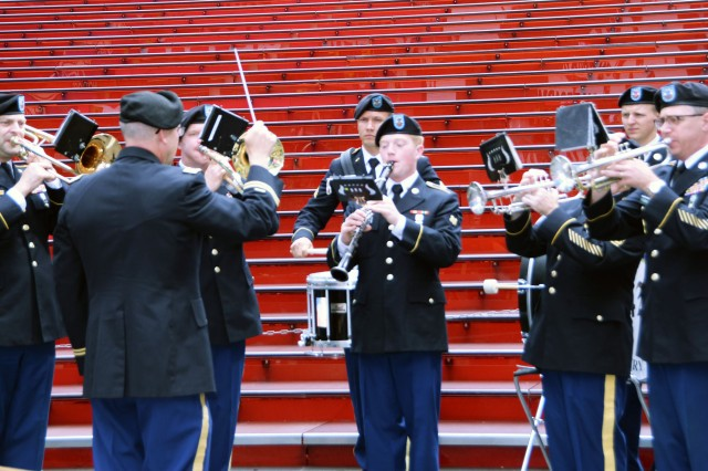 "Soldiers from the New York Army National Guard 42nd Infantry Division Band, under the direction of Chief Warrant Officer 3 Mark Kimes, provide musical support during the ceremony to honor the life and career of New York Army National Guard Chaplain Father Francis P. Duffy at Times Square June 27, 2018. Archbishop of New York Cardinal Timothy Dolan, WWI National Commissioner Dr. Libby O'Connell and the National Guard's senior chaplain, Chaplain (Brig. Gen.) Kenneth ""Ed"" Brandt joined New York Army National Guard Lt. Col. Don Makay, commander of the 1st Battalion, 69th Infantry to commemorate Duffy's service in WWI with the regiment."