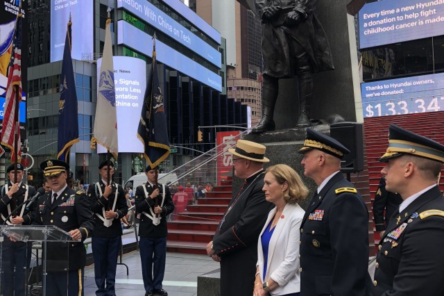 "New York Army National Guard Chaplain (Lt. Col.) Scott Ehler, left, introduces the official party to commemorate the life and career of New York Army National Guard Chaplain Father Francis P. Duffy at Times Square June 27, 2018. Ehler joined with Archbishop of New York Cardinal Timothy Dolan, WWI National Commissioner Dr. Libby O'Connell and the National Guard's senior chaplain, Chaplain (Brig. Gen.) Kenneth ""Ed"" Brandt to commemorate Duffy's service in WWI."
