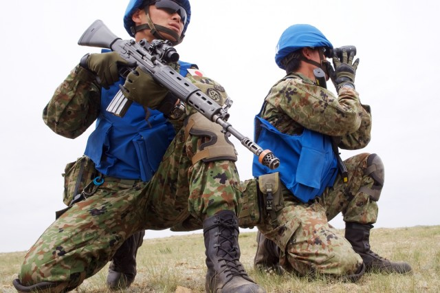 Japan Ground Self-Defense Force Sgt. 1st Class Junya Sawada and Sgt. Yuta Takano close ranks after neutralizing a simulated rebel June 21, 2018, at Five Hills Training Area, Mongolia, during a Khaan Quest 2018 patrolling lane. The purpose of Khaan Quest is to gain United Nations training and certification for the participants through the conduct of realistic peace support operations, to include increasing and improving U.N. peacekeeping interoperability and military relationships among the participating nations.