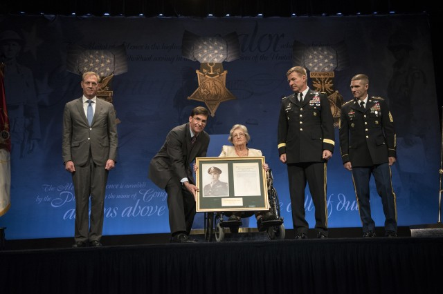 Deputy Secretary of Defense Patrick M. Shanahan and Secretary of the Army Mark T. Esper, host the Medal of Honor award ceremony for First Lieutenant Garlin M. Conner at the Pentagon Auditorium in Washington, D.C., June 27, 2018. Conner's wife accepted the award on his behalf.