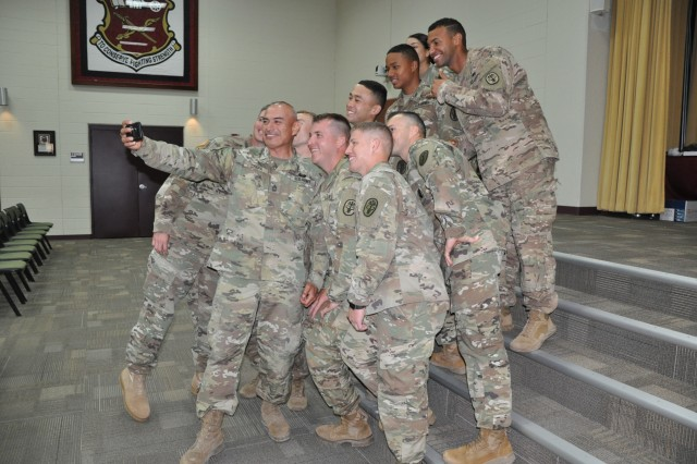 The 2018 Best Warrior competitors gather with Master Sgt. Dagoberto Chapa for a selfie after an awards presentation June 28, 2018, in the Army Medical Department Center and School on Fort Sam Houston, Texas. Sgt. Joshua Meyer, Medical Research and Materiel Command, was named the 2018 U.S. Army Medical Command non-commissioned Officer Best Warrior of the Year. Sgt. Beatrice Clark, Regional Health Command-Central, was named the 2018 MEDCOM Soldier Best Warrior of the Year. The BWC is an annual week-long event Soldiers on their physical and mental capabilities. The top NCO and Soldier will move on to compete in the Army-wide BWC at Fort A.P. Hill, Va. (U.S. Army photo by Courtney Dock)