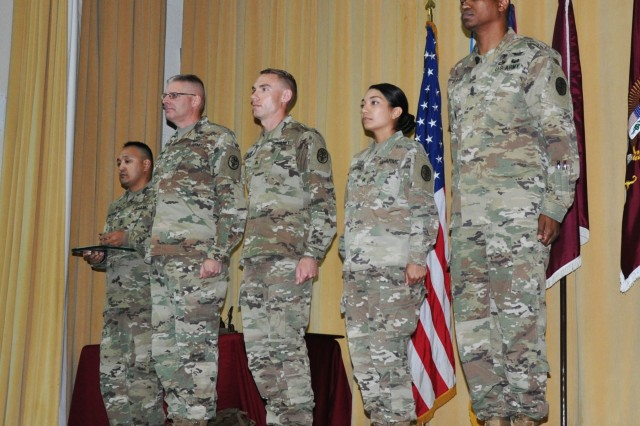 Brig. Gen. Jeffrey J. Johnson, Commanding General, U.S. Army Regional Health Command-Central, and Command Sgt. Maj. Michael L. Gragg, Command Sergeant Major, U.S. Army Medical Command present Army Commendation Medals for meritorious achievement to Sgt. Joshua Meyers and Sgt. Beatrice Clark, NCO and Soldier 2018 MEDCOM Best Warrior Competition winners, during an awards presentation June 28, 2018, on Fort Sam Houston, Texas. The BWC is an annual week-long event Soldiers on their physical and mental capabilities. The top NCO and Soldier will move on to compete in the Army-wide BWC at Fort A.P. Hill, Va. (U.S. Army photo by Courtney Dock)
