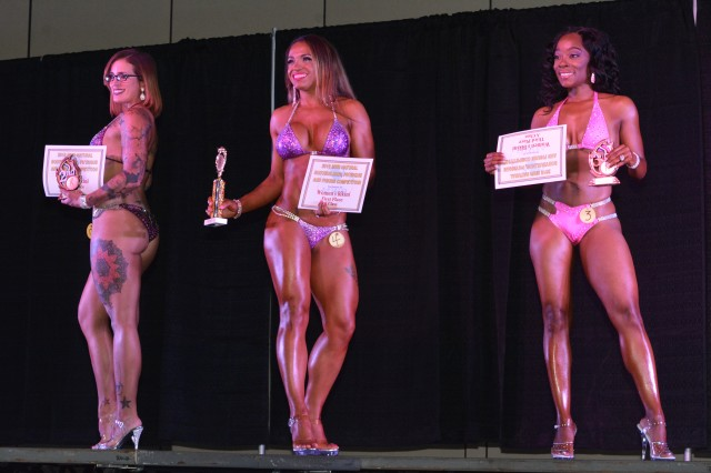 Woman's Bikini Division Class A winners: Bridget Trapp, second place; Babila Fasel-Murillo, first place and over all winner; and QuShawanda Mitchell, third place, accept their recognitions June 23 during the annual Directorate of Family, Morale, Welfare and Recreation Natural Bodybuilding Physique & Figure Competition.