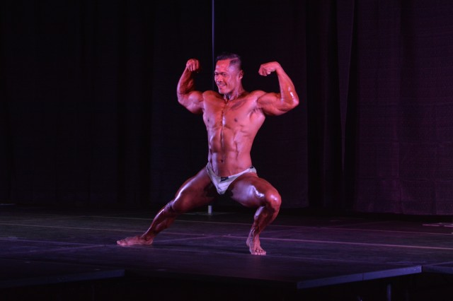 Guest poser Daniel Malabug flexes for the audience during his performance June 23 at the seventh annual Directorate of Family, Morale, Welfare and Recreation Natural Bodybuilding Physique and Figure Competition.