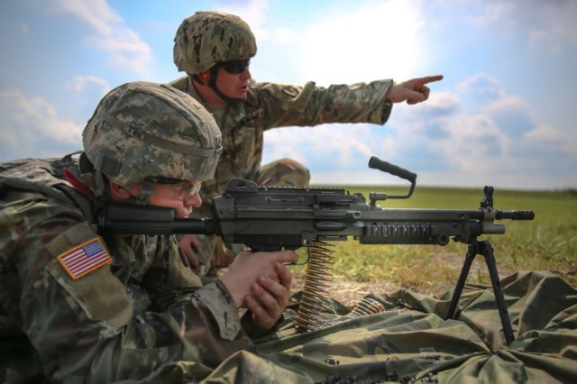 U.S. Army Pfc. Robert Nelson fires a M249 Light Machine Gun during the 2017 Army Materiel Command's Best Warrior Competition July 18, 2017, at a range in Camp Atterbury, Indiana. During the three-day competition, Soldiers are tested on basic and advanced warrior tasks and drills. Nelson is assigned to 687th Rapid Port Opening Element. (U.S. Army photo by Sgt. 1st Class Teddy Wade)