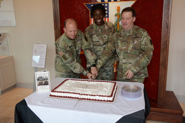 Col. David Gibson, commander of Carl R. Darnall Army Medical Center, 1st Lt. Brooke Hollaway, 187th Medical Battalion, and Col. Terry Lantz, Medical Service Corps (MSC), Corps Specific Branch Proponent Officer, cut the ceremonial cake to honor the MSC on its 101st birthday.