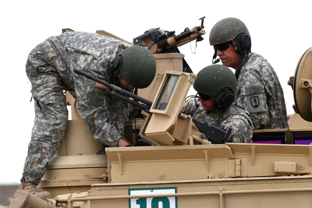 An instructor with the Idaho Army National Guard's 204th Regiment (Regional Training Institute), right, looks on as students prepare an M1 Abrams tank for a training evolution at Gowen Field, Idaho. Located in every state and part of the One Army School System, the Army National Guard-run regional training institutes provide training on a variety of subjects ranging from leadership courses needed for promotion to functional training on specific systems, equipment and procedures as well as courses for those transitioning to a new military operational specialty.