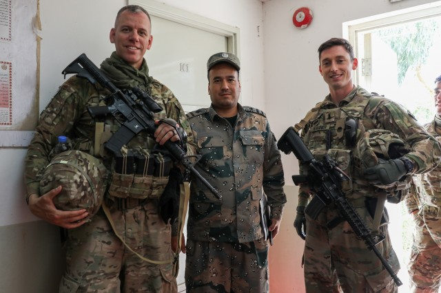 Maj. David Weiss, left, advisor for the Afghan National Army and Afghan National Police border patrol force for Train, Advise and Assist Command-South and a member of the 40th Infantry Division, California National Guard, and 1st Lt. Brain Wagner, right, advisor with the Police Advisory Team of TAAC-South and a member of the 2nd Infantry Brigade Combat Team, 4th Infantry Division, pose for a photo, April 17, 2018, with an Afghan police leader, center, at Camp Hero in Kandahar, Afghanistan. TAAC-South is a joint Army component command composed of Soldiers from the 40th Infantry Division, California National Guard and the 2nd Infantry Brigade Combat Team, 4th Infantry Division. (U.S. Army photo by Staff Sgt. Neysa Canfield/TAAC-South Public Affairs)