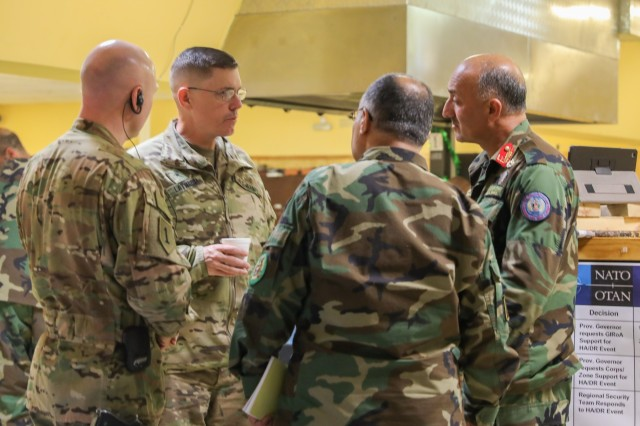 Brig. Gen. John Lathrop, center, commanding general for Train, Advise and Assist Command-South, talks to senior Afghan leaders, March 19, 2018, during an Afghan led exercise in Kandahar, Afghanistan. TAAC-South is a joint Army component command composed of Soldiers from the 40th Infantry Division, California National Guard and the 2nd Infantry Brigade Combat Team, 4th Infantry Division. (U.S. Army photo by Staff Sgt. Neysa Canfield/TAAC-South Public Affairs)