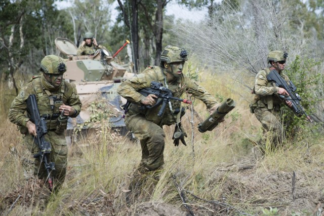 Soldiers from Battlegroup War Horse take part in the final assault on Williamson Airfield in the Shoalwater Bay Training Area, Rockhampton, Queensland, during Exercise Hamel 2018. Exercise Hamel 2018 is the operational readying certification for the 7th Brigade of The Australian Army. The exercise is also a coalition joint task force activity which maximises interoperability training with Australia's Five Eyes partners, the United States, United Kingdom, Canada and New Zealand.