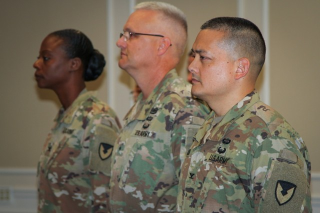 Col. Kim M. Thomas (background), outgoing commander of the 408th Contracting Support Brigade, Brig. Gen. Paul H. Pardew (center), commanding general, U.S. Army Contracting Command, and Col. Ralph T. Borja, incoming commander of the 408th CSB, stand at attention during the 408th's change-of-command ceremony at the Carolina Skies Club and Conference Center at Shaw Air Force Base, South Carolina, June 22, 2018. (U.S. Army Photo by Sgt. Von Marie Donato)