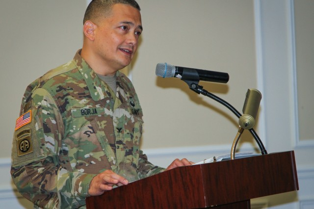 Col. Ralph T. Borja, incoming commander of the 408th Contracting Support Brigade, shares his remarks during a change-of-command ceremony at the Carolina Skies Club and Conference Center at Shaw Air Force Base, South Carolina, June 22, 2018. (U.S. Army Photo by Sgt. Von Marie Donato)