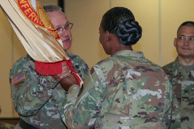 Col. Kim M. Thomas, outgoing commander of the 408th Contracting Support Brigade, passes the unit colors to Brig. Gen. Paul H. Pardew, commanding general, U.S. Army Contracting Command, during a change-of-command ceremony at the Carolina Skies Club and Conference Center at Shaw Air Force Base, South Carolina, June 22, 2018. (U.S. Army Photo by Sgt. Von Marie Donato)