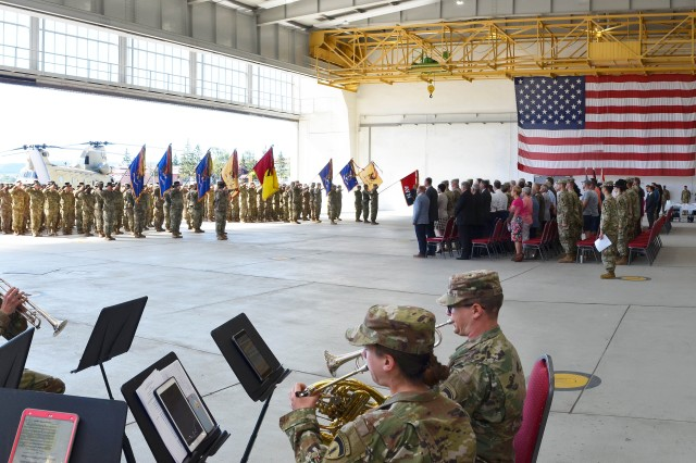 ILLESHEIM, Germany— A Hand Over Take Over ceremony was held July 2 at the U.S. Army Ansbach Garrison's Storck Barracks Airfield for the first of the expected 1,700 Soldiers of the 4th Combat Aviation Brigade (4th CAB) arriving in theater from Fort Carson, Colorado. The brigade, led by Col. Scott Gallaway, Commander, 4th Combat Aviation Brigade, participated in the ceremony at the Storck Barracks airfield in Illesheim marking the start of its deployment to Europe. As part of the regular rotation of forces, the 4th Combat Aviation Brigade replaces the 1st Air Cavalry Brigade (1st ACB) and support combatant commander mission requirements for U.S. European Command's Atlantic Resolve. The 1st ACB redeploys back to its home base at Fort Hood, Texas. To learn more about the people and facilities of the U.S. Army Garrison Ansbach (USAG Ansbach) and the people they support in Ansbach, Katterbach and Illesheim, visit the community website at www.ansbach.army.milPhoto by Michael Beaton U.S. Army Garrison Ansbach Public Affairs (RELEASED).