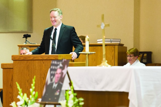 Lt. Gen. Max Noah is remembered fondly by his son, Van, during a memorial service at Woodlawn Chapel, Friday. After a lifetime of service, Noah, a former commander of the Army Engineer School on Belvoir, passed away June 15.