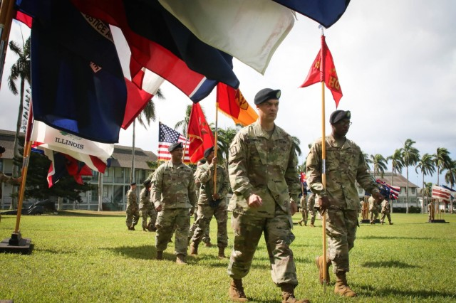 1st Sgt. Thomas A. Johnson, senior noncommissioned of Headquarters and Headquarters Battery, 94th Army Air and Missile Defense Command, marches the battery's colors onto the parade field during the 94th Army Air and Missile Defense Command's change of responsibility ceremony at historic Palm Circle on Fort Shafter, Hawaii, June 26, 2018.