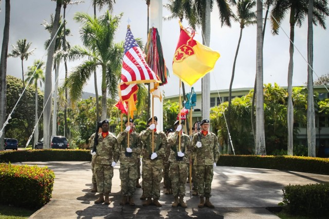 The 94th Army Air and Missile Defense Command, color guard moves to position the colors at the center of the formation, symbolically and historically representing their presence at the forefront of battle, during the 94th AAMDC change of responsibility ceremony at historic Palm Circle on Fort Shafter, Hawaii, June 26, 2018.