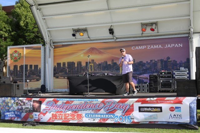 Col. Phillip K. Gage, commander of U.S. Army Garrison Japan, welcomes event attendees during the 242nd birthday celebration of the United States held June 30, 2018 at Camp Zama's Yano Field. (U.S. Army Photo by Noriko Kudo)