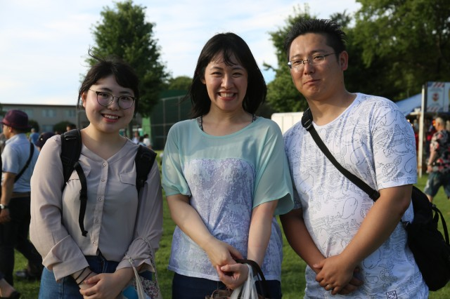 Event attendee Mei Takahashi, left, takes a group picture with her friends during the 242nd birthday celebration of the United States held June 30, 2018 at Camp Zama's Yano Field. (U.S. Army Photo by Noriko Kudo)