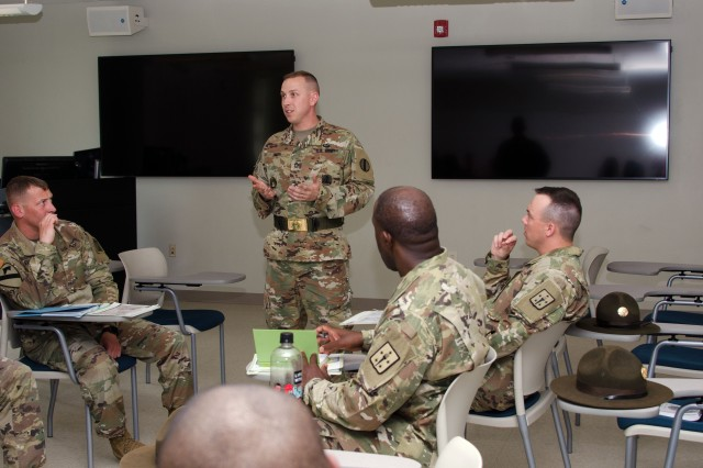 Sgt. 1st Class Corey Smith, chief of training for the U.S. Army Drill Sergeant Academy, speaks during the Drill Sergeant Program of Instruction Symposium June 26.