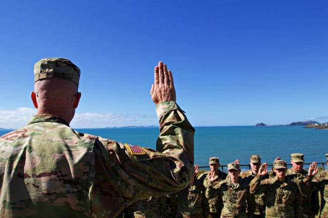 Members of the Indiana National Guard raise their right hands as their brigade commander, Col. Robert Burke, leads them through a once-in-a-lifetime reenlistment ceremony in Yeppoon, Australia, on July 3, 2018. The 76th Infantry Brigade Combat Team is training with the Australian Army during Exercise Hamel, a multi-national exercise held annually in nearby Shoalwater Bay Military Training Area.