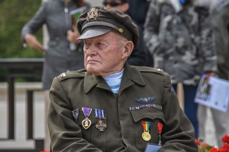 B-29 Bomber pilot and recipient of two Distinguished Flying Crosses and two Purple Hearts, Lt. Denny Thompson, of the U.S. Army Air Corps is recognized at the Normandy American Cemetery commemorating the 74th D-Day.