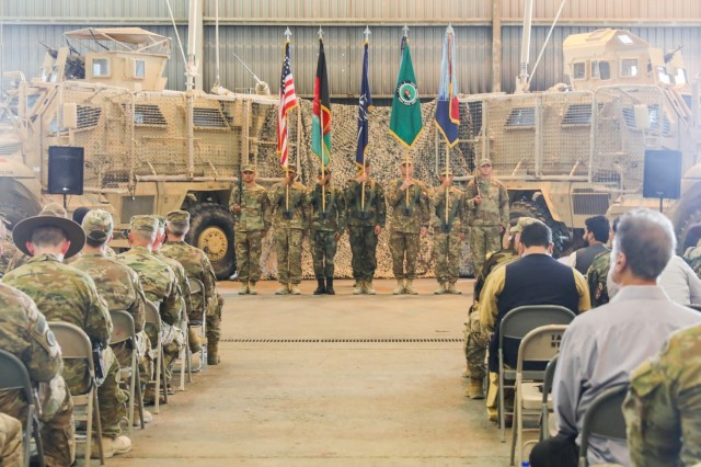 KANDAHAR AIRFIELD, Afghanistan (June 30, 2018) --The color guard, composed of U.S. Army, Romanian, and Bulgarian Soldiers, stand in the middle of the ceremony area, June 30, 2018, during a Transfer of Authority ceremony for Train, Advise and Assist Command-South in Kandahar, Afghanistan. U.S. Army Brig. Gen. John Lathrop, outgoing commander for TAAC-South, relinquished authority of TAAC-South to U.S. Army Brig. Gen. Jeffrey Smiley, incoming commander.  (U.S. Army photo by Staff Sgt. Neysa Canfield/TAAC-South Public Affairs)