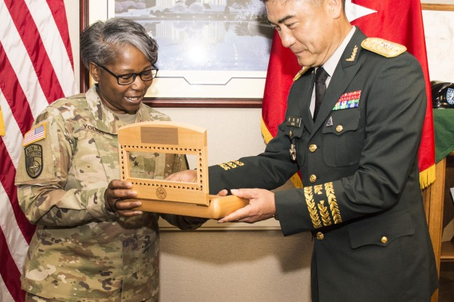 "Brig. Gen. Twanda ""Tia"" Young, deputy commanding general, U.S. Army Human Resources Command, presents a gift to Brig. Gen. Son Seck Min, Republic of Korea Army G-1 deputy, June 27, in the HRC command headquarters at Fort Knox. Min met with Young and various HRC staff to discuss personnel and talent management."