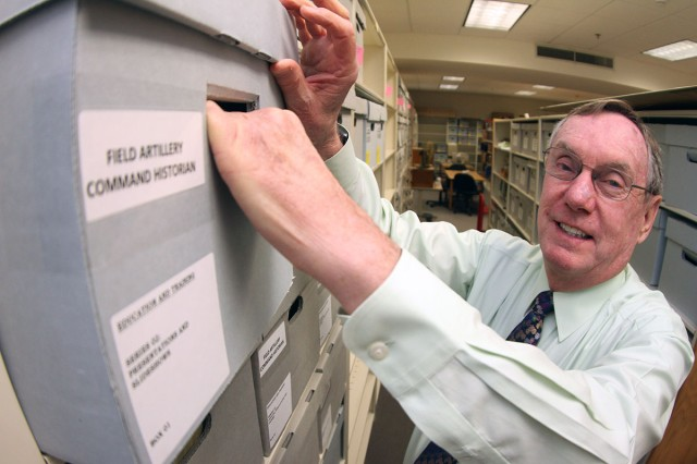 Dr. Boyd Dastrup removes one of the file boxes that contain memorandums, decision papers, and white papers about field artillery (FA) and Fort Sill, June 29,  2018, in his office in Snow Hall. The files are part of the Army's historical documents and records collection. Dastrup has been the FA School, and FA branch historian for 34 years.