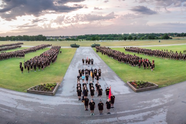 Soldiers, families and friends of the Chemical Corps gather for a group photo June 27 before embarking on a two-mile regimental run in honor of the corps' 100th birthday.