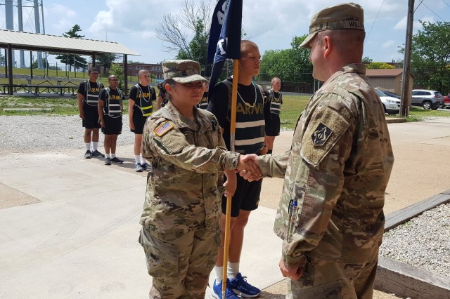 Pvt. Cassy McKnight receives a coin from Capt. Edward Williams, FTU commander, June 27, 2018. McKnight overcame a severe injury to finish basic training through the Warrior Training and Rehabilitation Program.