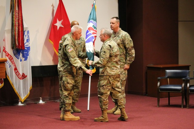 """During a Change of Responsibility ceremony on July 3, the U.S. Army Aviation and Missile Command honored outgoing Command Sgt. Maj. Michael O'Donnell, and welcomed its eighth Command Sergeant Major, Command Sgt. Maj. George """"Mike"""" Dove. Maj. Gen. Doug Gabram, AMCOM commander, thanked O'Donnell for his 30 years of service to the Nation, and the legacy he leaves behind in the Soldiers and civilians he has touched throughout his career. """"The knowledge and skills will be difficult to replace, but he has trained us well. The words of the Noncommissioned Officer Creed embodies Command Sgt. Maj. O'Donnell and his 30 year career."""" Looking toward Command Sgt. Maj. Dove, Gabram highlighted stated that he will bring an important strategic perspective to the Command, and his experience will take us to the next level. Gabram left Dove with the charge to """"prepare to row hard and row fast."""""""